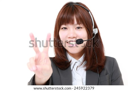 businesswoman of call center showing victory sign - stock photo