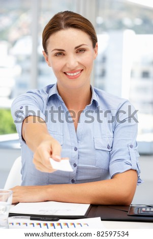 Businesswoman offering business card - stock photo
