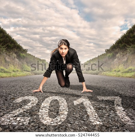 businesswoman on a road ready to start a new year
