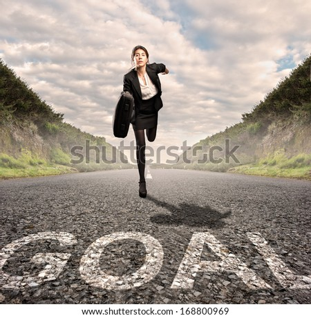 businesswoman on a road running. Motivation concept. - stock photo