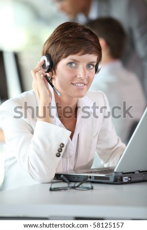 Businesswoman on a video conference - stock photo