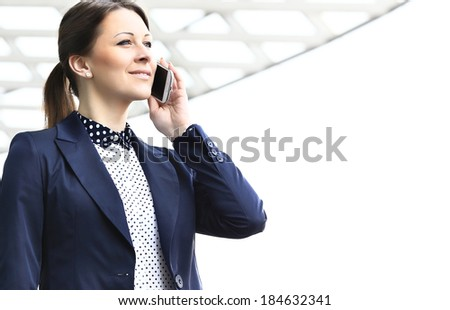 Businesswoman on cellphone outdoor  talking on smart phone - stock photo