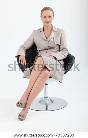 businesswoman on chair - stock photo
