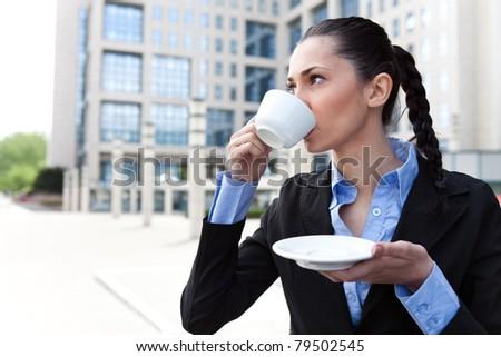 businesswoman on coffee break drinking coffee, outdoor - stock photo
