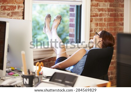 Businesswoman On Phone Relaxing In Modern Creative Office - stock photo