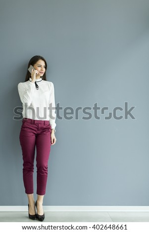 Businesswoman on the phone in the office - stock photo