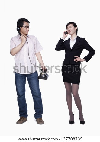 Businesswoman on the phone, man with stationary phone