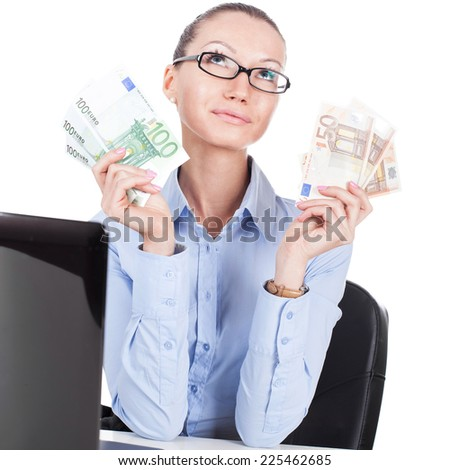 Businesswoman on workplace with euro banknotes in hands  - stock photo