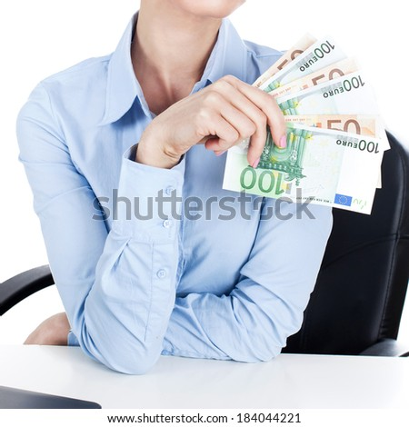 Businesswoman on workplace with euros in hand  - stock photo