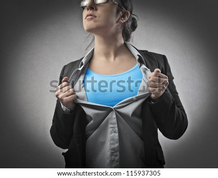 Businesswoman opening his shirt like a superhero - stock photo