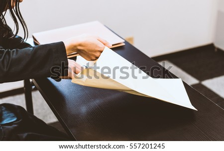 Businesswoman opening the envelope
