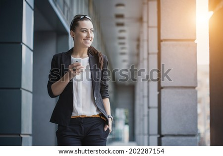 businesswoman or entrepreneur talking on cellphone. City businesswoman working.