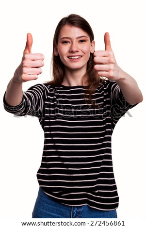 Businesswoman or student showing thumbs up sign stock image - stock photo