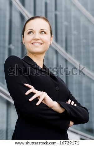 Businesswoman outside a modern office building - stock photo