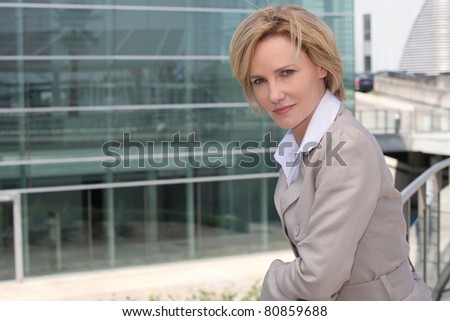 Businesswoman outside airport - stock photo