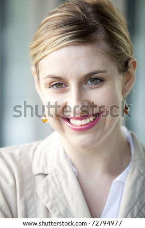 Businesswoman outside her office with hand gesturing, very happy - stock photo