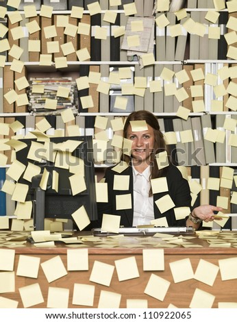 Businesswoman overloaded with reminding notes - stock photo