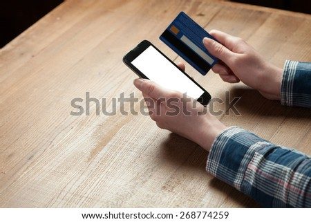 Businesswoman Paying With Credit Card On Mobile Phone - stock photo