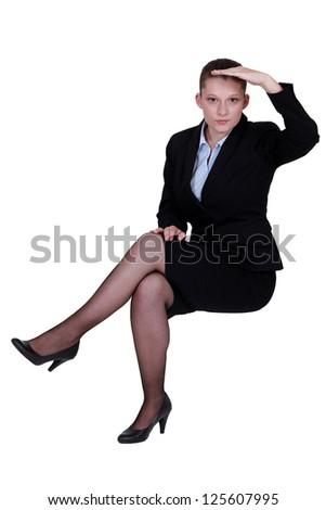 Businesswoman peering into the distance - stock photo