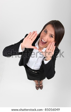 businesswoman playing the fool - stock photo