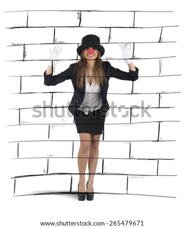 Businesswoman plays to mime imagining a wall - stock photo