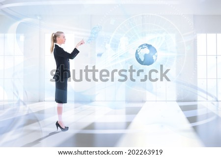 Businesswoman pointing against bright room with windows - stock photo