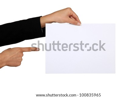 Businesswoman pointing at a blank piece of paper - stock photo