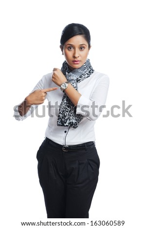 Businesswoman pointing toward a wristwatch - stock photo