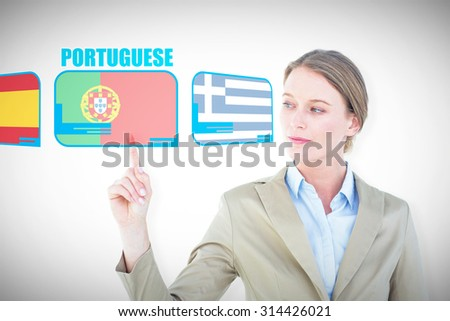 Businesswoman pointing with her finger against white background with vignette - stock photo