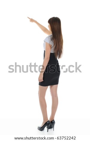 Businesswoman points finger up. Isolated on white background