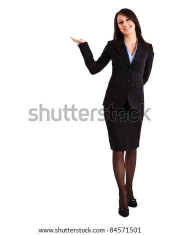 Businesswoman portrait full length in a welcome pose - stock photo