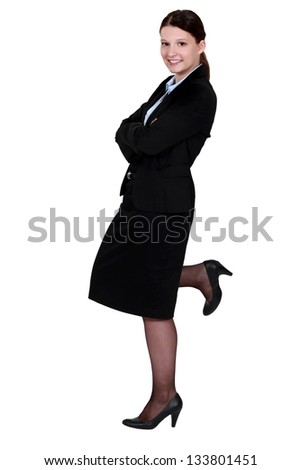 Businesswoman posing in a skirt suit - stock photo