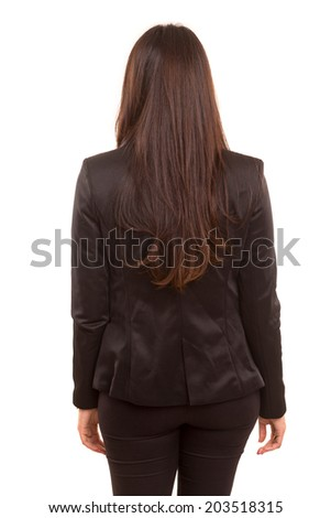 Businesswoman posing with her back faced to camera, isolated over copy space background