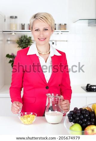 businesswoman preparing breakfast before work - stock photo