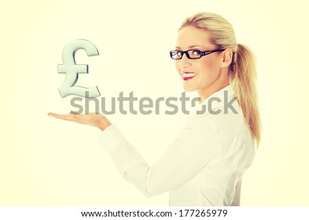 Businesswoman presenting British currency over white - stock photo