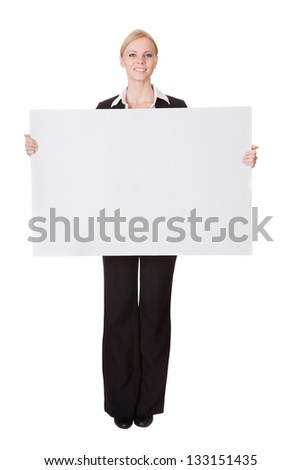 Businesswoman presenting empty banner. Isolated on white - stock photo