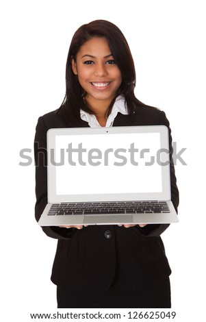 Businesswoman Presenting Laptop. Isolated On White Background - stock photo