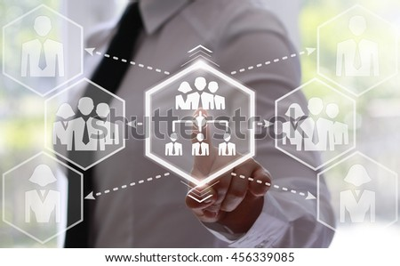 Businesswoman presses a network of businessman. Businessman toched a team of businessman icon on touch screen. Communication, connect, interrelation, interaction, networking, communication, connection - stock photo