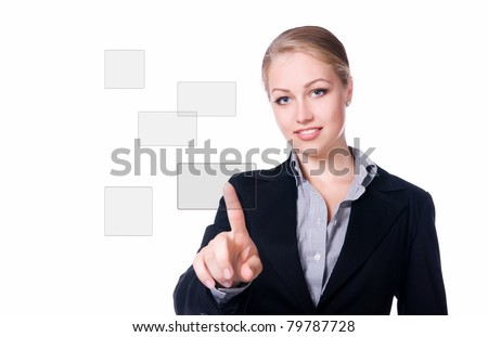 businesswoman pressing a touchscreen button. Studio shot - stock photo