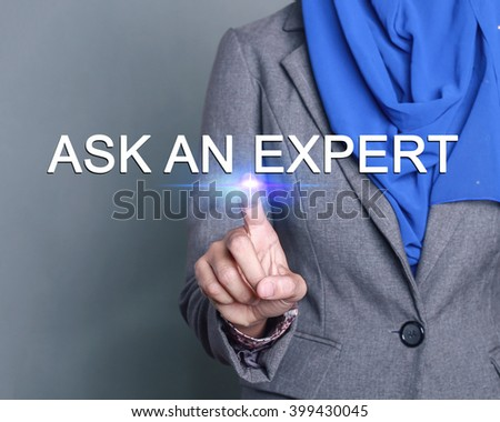 Businesswoman pressing ask an expert button on virtual screens - stock photo