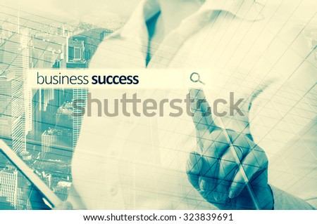 Businesswoman Pressing Business Team Search Button.  Business success - stock photo