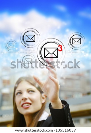 Businesswoman pressing email icons with virtual background - stock photo
