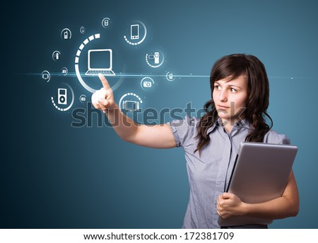 Businesswoman pressing multimedia type of modern buttons with virtual background - stock photo