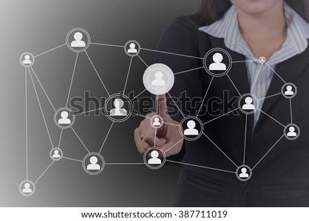 Businesswoman pressing network icon. - stock photo