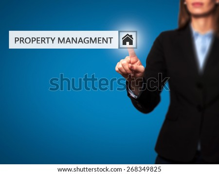 Businesswoman pressing  property management button on virtual screens. Woman finger on Property Icon. Isolated on blue. Business, technology, internet and networking concept -  Stock Image
