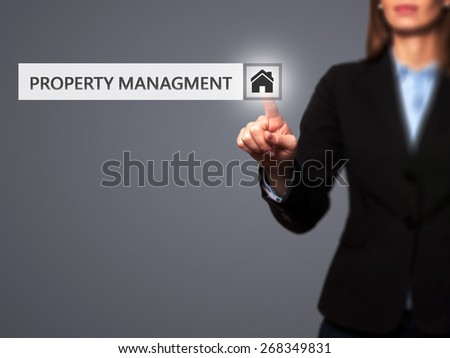 Businesswoman pressing  property management button on virtual screens. Woman finger on Property Icon. Isolated on grey. Business, technology, internet and networking concept -  Stock Image