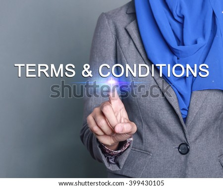 Businesswoman pressing terms and conditions button on virtual screens - stock photo