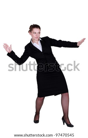 Businesswoman pretending to surf - stock photo