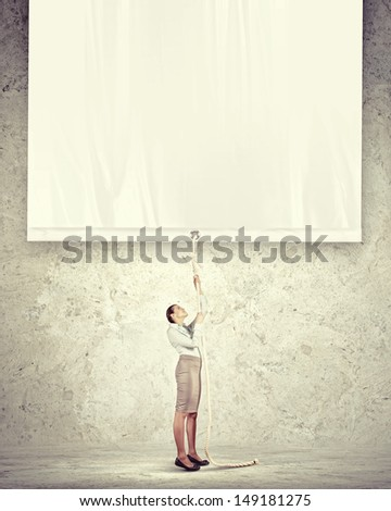 Businesswoman pulling blank banner. Place for text - stock photo