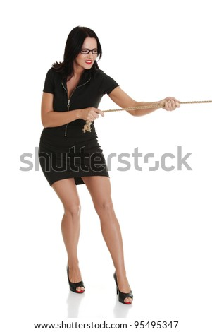 Businesswoman pulling on a long piece of rope, isolated on white background - stock photo